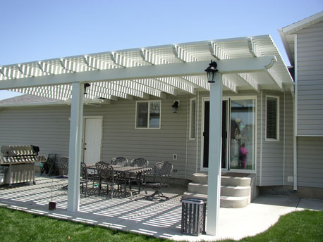 White lattice covers over cement patio off roof