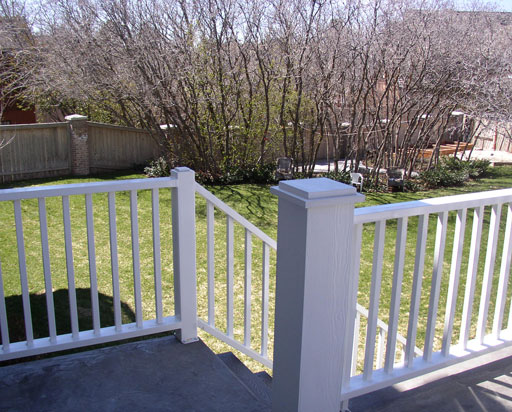 Grey composite deck material with white railing